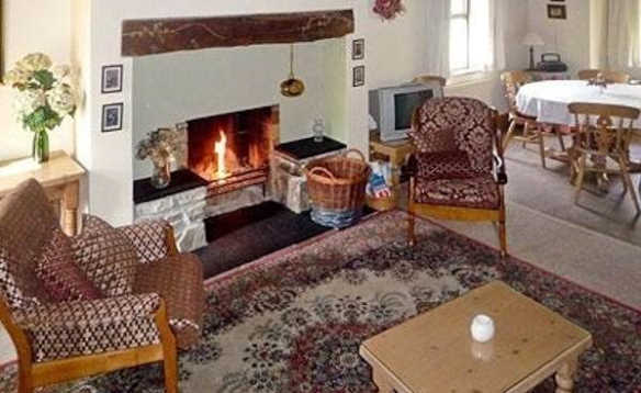 Peat fire burning in an open fireplace in the lounge of Cornode self-catering cottage in Ireland/