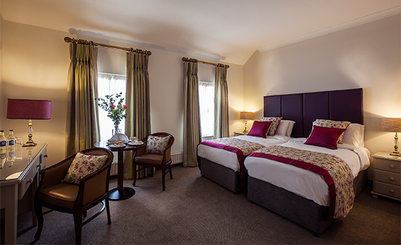 Bedroom with a large double bed in the Breffni Arms Hotel, Arva/