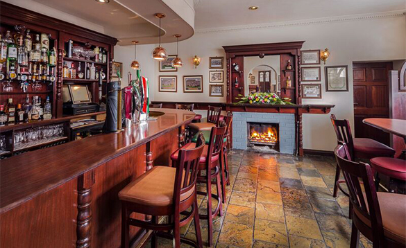 Open fire burning in the fireplace in the bar at the Breffni Arms, Arva/