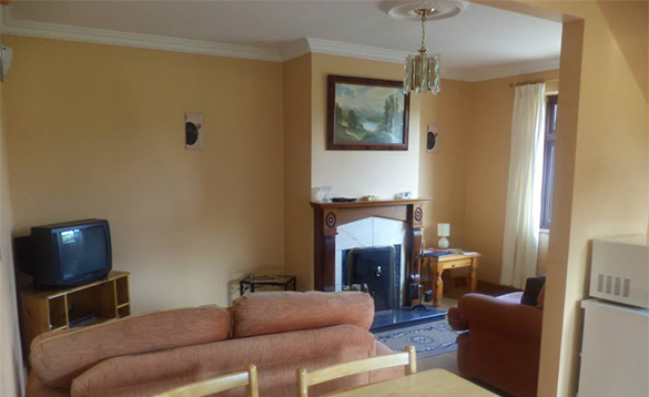 Lounge with open fire in the Annexe at Enaghan self-catering in Ireland/