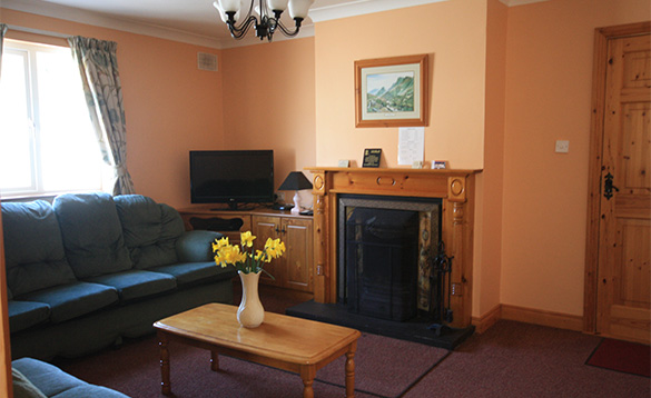 Lounge with open fire at Orchard View, self-catering house near Cootehill, Ireland/