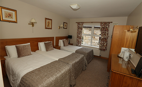 Bedroom at the Keepers Arms with double and single bed/