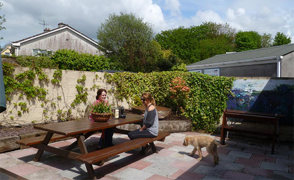 Two ladies enjoying a drink on the patio area at O'Callaghan's Bar in Coachford/