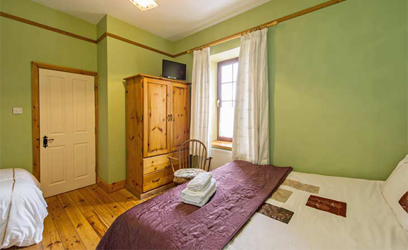 Bedroom with double and single bed at O'Callaghan's Bar, Coachford/