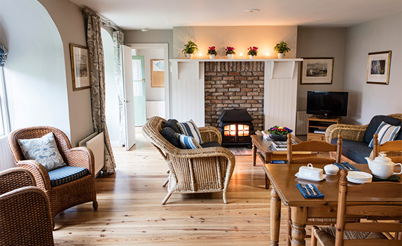 Lounge with feature log burner at the Courtyard apartments at Belle Isle/