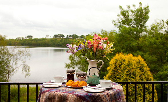 Table set for breakfast on a balcony with views over Lough Erne/