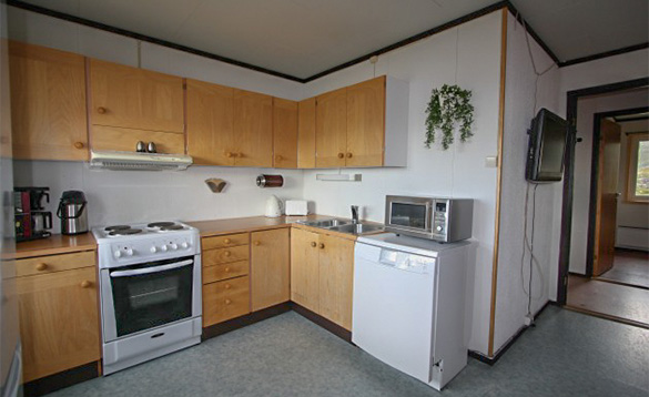 kitchen with pine units and grey flooring/