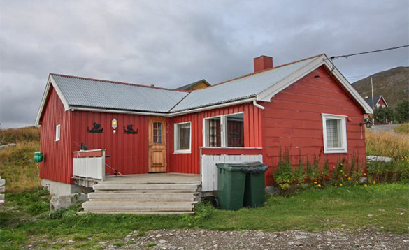single storey cabin painted russett red /
