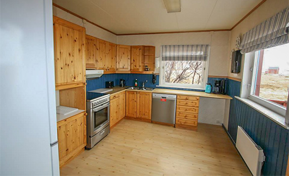 kitchen with pine units and laminate light wood flooring/