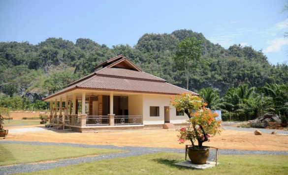 Bungalow at the foot of tree covered hills in Thailand/