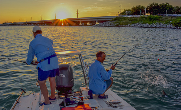 Two anglers fishing from a boat in Florida/
