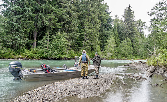 anglers and boat on river in British Columbia/