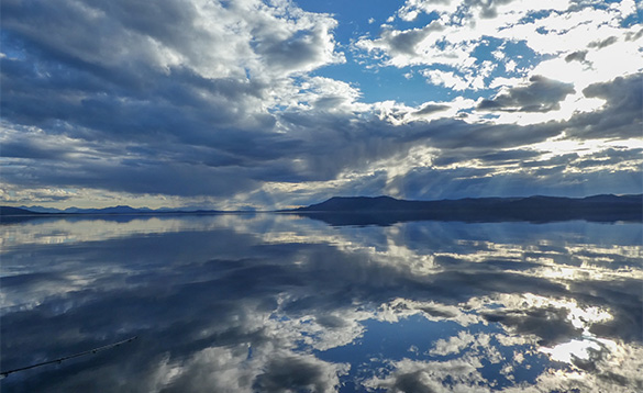 Clouds reflected in the calm waters in the Yukon/