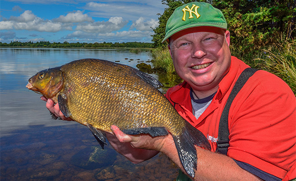 angler holding a bream/