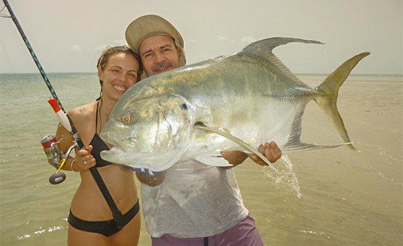 Lady with angler holding a Jack Crevalle caught in the Bijagos Archipelago Guinea Bissau/