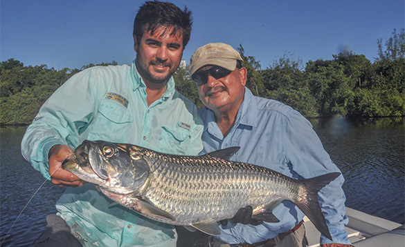 Two anglers holding a tarpon caught in Puerto Rico/