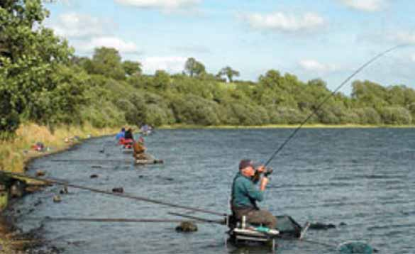 Anglers fishing from the shore of a big Irish Lake/