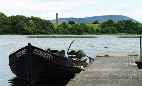 Rowing boat moored against a jetty on Lough Derg/