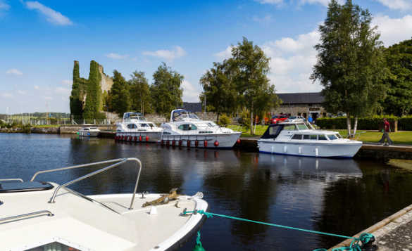 Cruisers moored in a marina on Lough Derg/