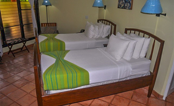 Bedroom with two single beds at Roberts Grove Beach Resort/