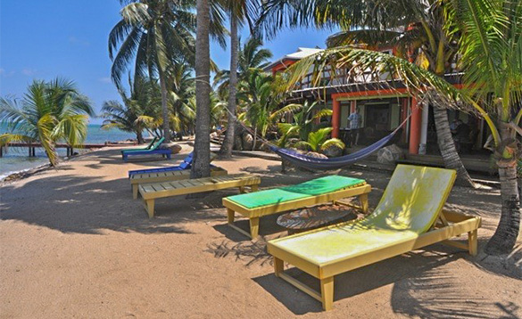 Sun loungers on a beach at Roberts Grove Beach Resort in Belize/