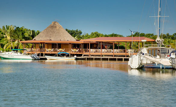Boats moored at Roberts Grove Beach Resort in Belize/