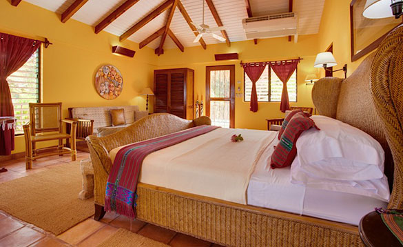 Bedroom with double bed at Roberts Grove Beach Resort in Belize/