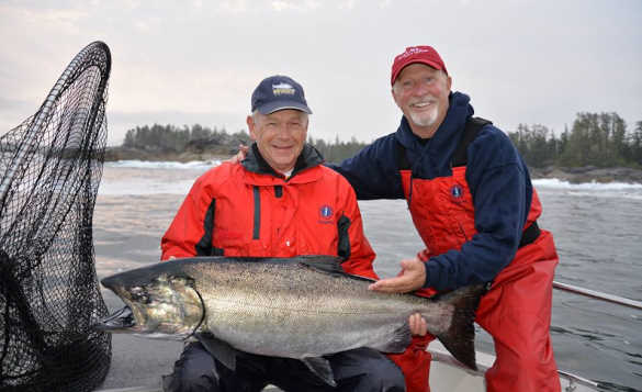 Two anglers holding a chinook salmon caught in British Columbia, Canada/