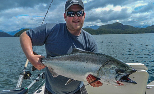 Angler holding a salmon caught near Tofino, Canada/