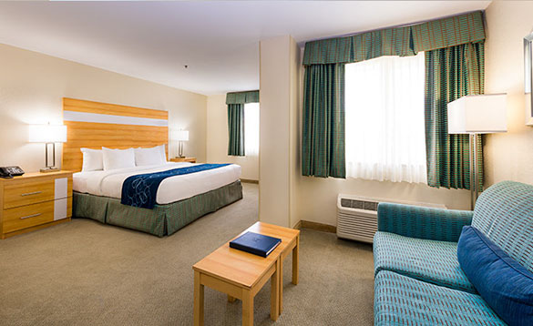 Hotel bedroom with double bed at the Comfort Suites hotel in Grand Cayman /