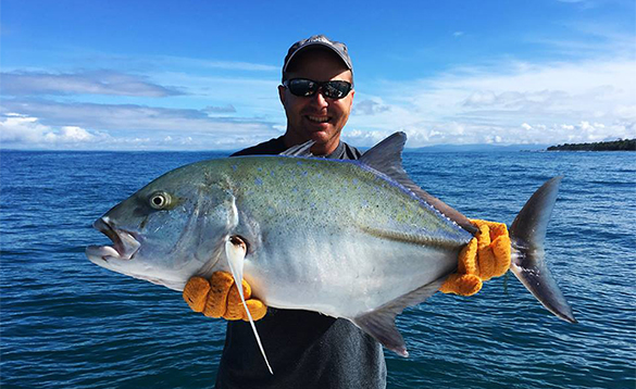 Angler holding a large Jack fish caught in Costa Rica/