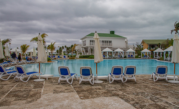Sun lounges around a pool in the Melia Cayo Coco hotel in Cuba/
