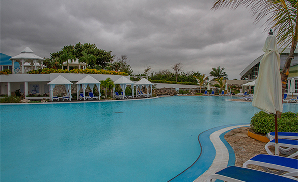 Sun loungers around a pool in Melia Cayo Coco hotel, Cuba/
