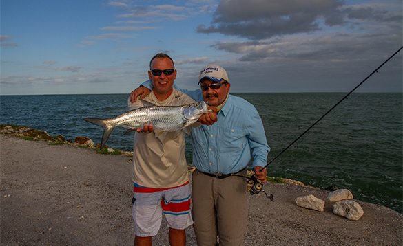 Two anglers with a tarpon caught in Cuba/