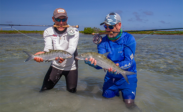 Two anglers each holding a bonefish caught in Cuba/