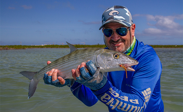 Angling holding a bonefish caught in Cuba/