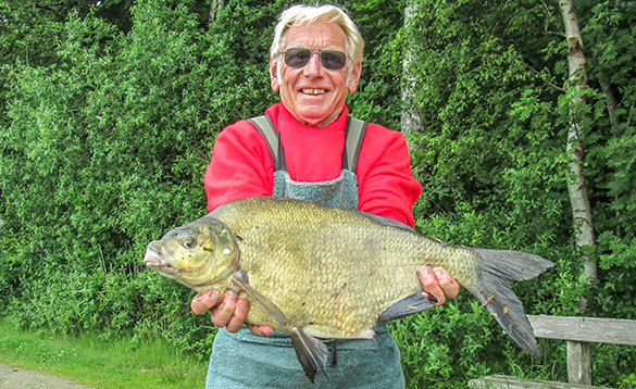 Angler holding a recently caught bream in Denmark/