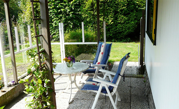 Veranda with patio furniture in an Authentic chalet at De Visotter holiday park/