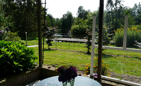 View across a river from a chalet at De Visotter holiday park/
