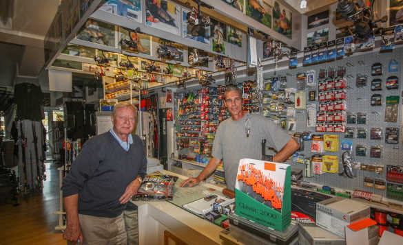 Angler asking for fishing advice from a tackle shop in Gorinchem, Holland/