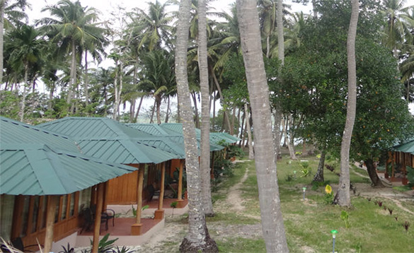 Row of wooden huts with porches at the Sands Marina Hotel, Havelock Island/