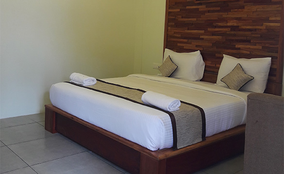 Bedroom with double bed and feature wooden headboard/