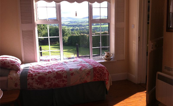 Bedroom with single bed and views of the Wicklow mountains/