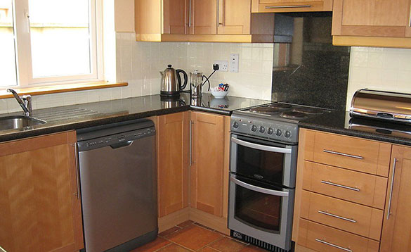 kitchen with beech units and tiled floor/