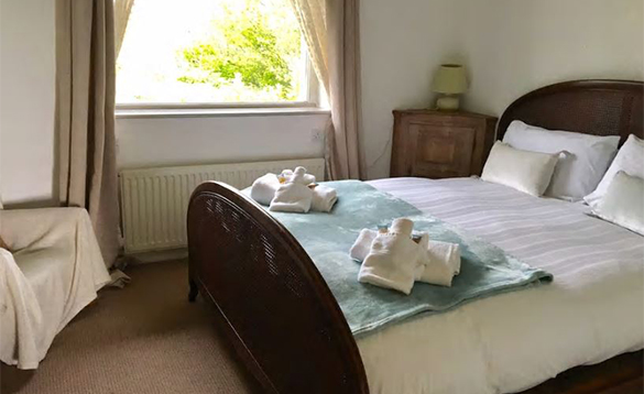 Bedroom with double bed at the Long House in Co Mayo/