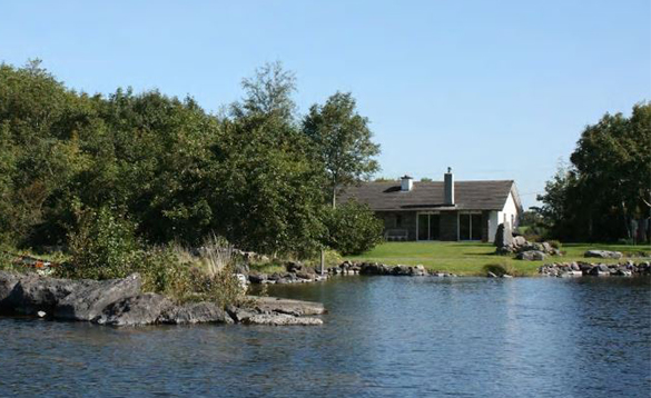 Bungalow with lawn leading to the shores of Lough Corrib in Ireland/