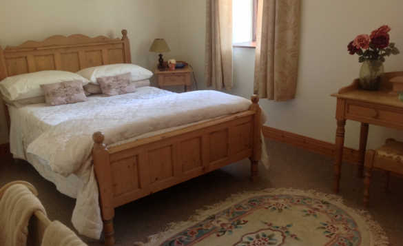 Bedroom at Fraoch self-catering with pine double bed /
