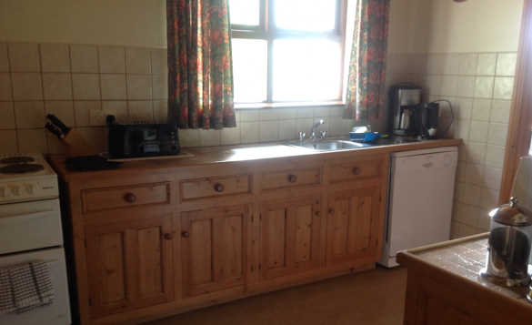 Kitchen at Fraoch self-catering cottage with pine units/