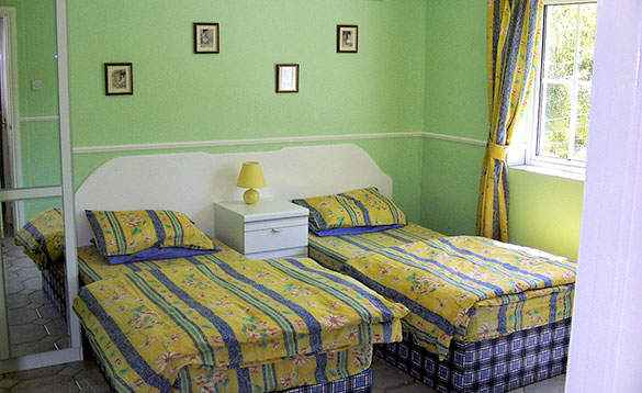Bedroom with two single beds at Alder Cottages, Cootehill/