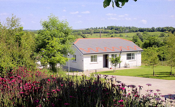 White self-catering bungalow set amongst Irish countryside/